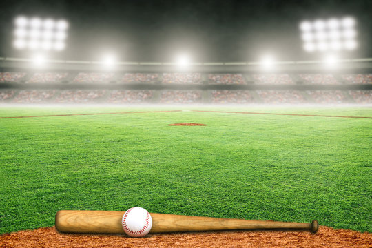Baseball Bat and Ball on Field in Outdoor Stadium With Copy Space