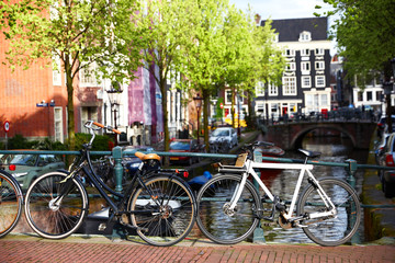 Amsterdam street canal with typical dutch houses and bikes. Holland, Netherlands