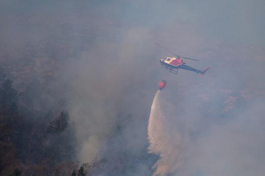 Helicopter extinguishing wildfire. Bergen, Norway.