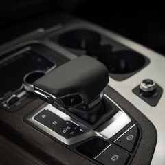 Automatic transmission in business car. Interior detail.
