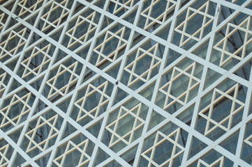 closeup of geometric jewish cross on building facade