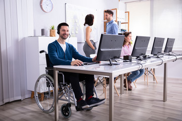 Handicapped Man Working On Computer