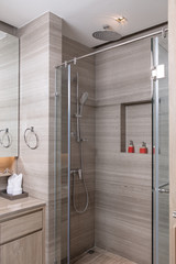 close up view of grey tiled nice modern stylish shower room