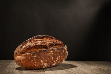 loaf of bread on a dark background