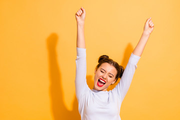 Fototapeta Portrait of her she nice-looking attractive lovely winsome sweet cheerful cheery optimistic girl having fun rejoicing raising hands up party isolated on bright vivid shine yellow background obraz