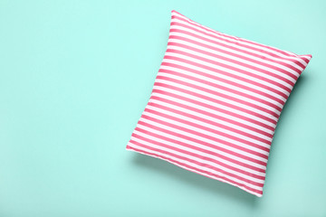 Soft striped pillow on mint background