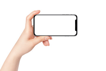 Female hand hold modern smartphone in horizontal position, isolated on white background. Mockup for presentation