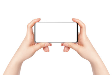 Female hands holding modern phone in horizontal position, isolated on white background. Mockup for presentation