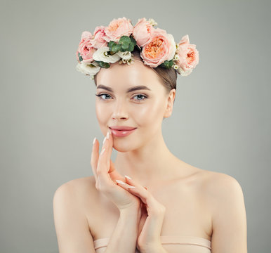 Smiling woman with clear skin. Spa model with flowers