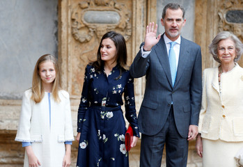 Members of the Spanish Royal Family pose for pictures as they arrive for an Easter Sunday Mass in Palma de Mallorca