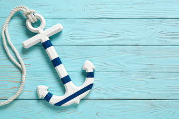 Anchor on Vintage Wooden Background .