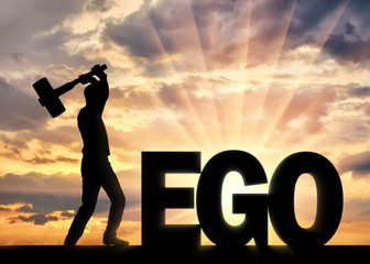 Man with a hammer in his hand intends to destroy the word ego