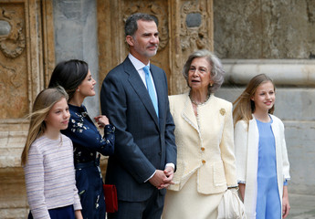 Members of the Spanish Royal Family pose for pictures as they leave after attending an Easter Sunday Mass in Palma de Mallorca