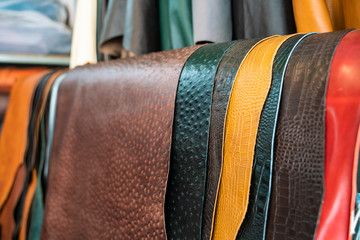 Raw genuine leather on shelf in crafts shop