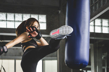 Athlete woman doing kick boxing training Wall mural