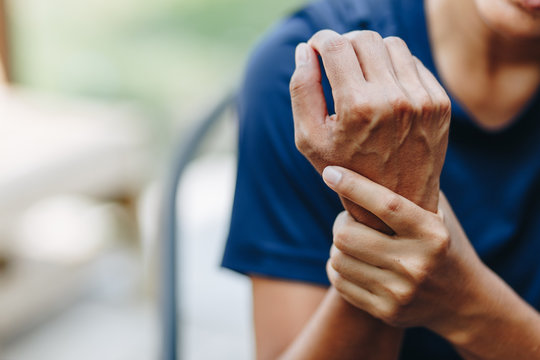 Close up young woman wrist pain, health care concept
