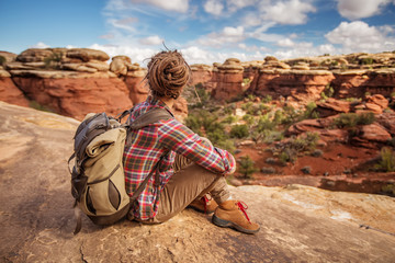Hiker in Canyonlands National park, needles in the sky, in Utah, USA Wall mural