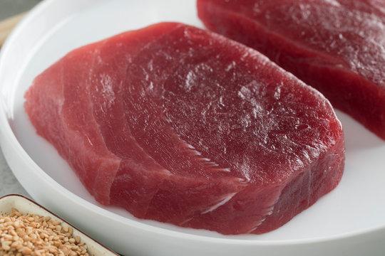 Dish with fresh raw yellowfin tuna steaks