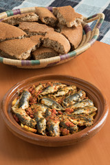 Wall Mural - Traditional  Moroccan Tagine with sardines and vegetables