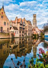 Wall Mural - Landscape with famous Belfry tower and medieval buildings along a canal in Bruges, Belgium