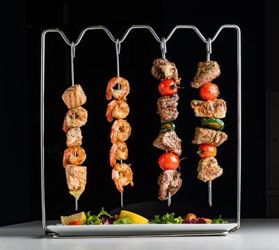 skewer set with shrimps, fish, beef and chicken
