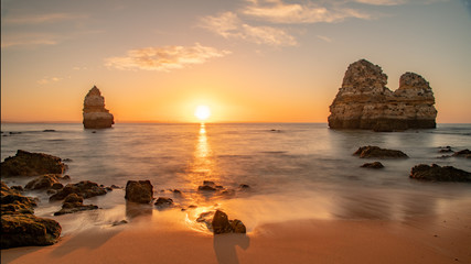 Beautiful sunset at famous beach near Lagos, Algarve, Portugal