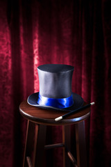 Wall Mural - high contrast image of magician hat and wand on stage