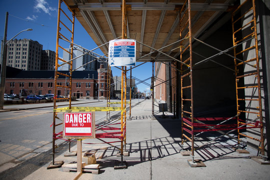 Covered Scaffolding Over Pedestrian Walkway Danger Due Restricted Area