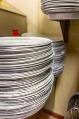 Wall Mural - Greased pizza pans in a restaurant kitchen