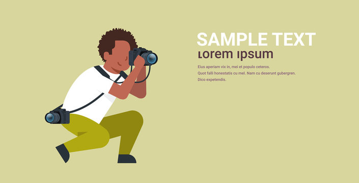 man professional photographer taking photo african american guy journalists or paparazzi taking photos using dslr camera horizontal full length flat copy space