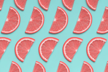 Pink grapefruit isoetric pattern on pastel blue background. Minimal summer fruit concept, pop art...