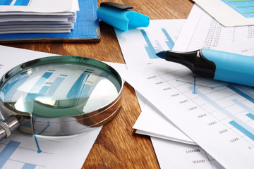 Audit and financial accounting concept. Magnifier and business report.