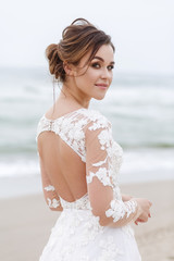 portrait of a cute young bride on the beach
