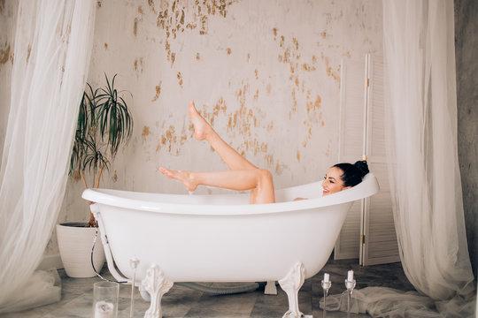 Beautiful sexy woman in bubble bathtub