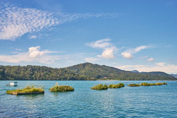 Beautiful nature scenics of Sun Moon Lake with the surrounding mountains are the highlight at this sprawling lake at Yuchi, Nantou in Taiwan.