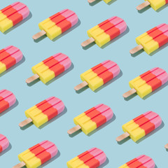 Colorful Ice cream popsicle pattern on pastel blue background. Minimal summer concept. Flat lay.