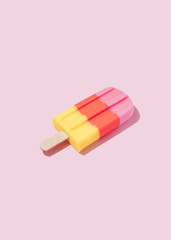 Colorful Ice cream popsicle on pastel pink background. Minimal summer concept. Flat lay.