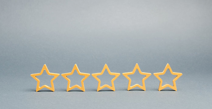 Five stars on a gray background. The concept of the best housing, luxury apartments VIP class. The best service and universal recognition, a high evaluation. Success. Feedback