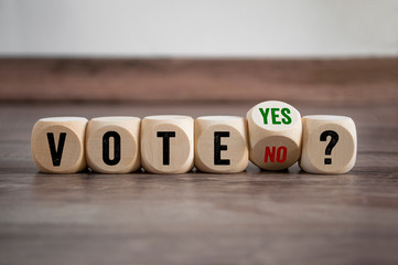 Cubes and dice with vote yes and no