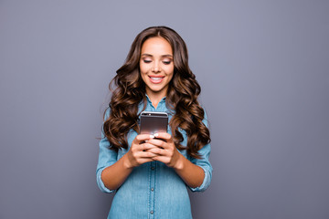Close up photo amazing beautiful her she lady hold arms hands smart phone reading news check likes followers group contact people wearing casual jeans denim shirt clothes isolated grey background