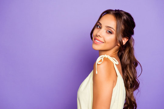 Close-up profile side view portrait of her she nice-looking attractive lovable fascinating magnificent winsome cheerful wavy-haired girl isolated over violet pastel background