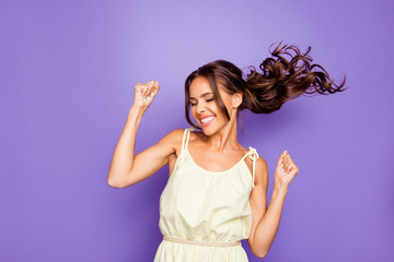 Close up photo of pretty attractive optimistic lovely she her lady raising fists hands up having free freedom inspiration isolated violet background Wall mural