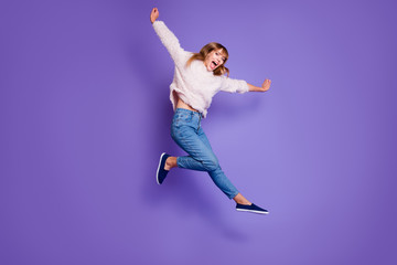 Wall Mural - Full length body size view photo cute energetic active teen teenager youth have holidays scream shout rejoice candid content isolated pullover denim blue sneakers raise hands arms purple background