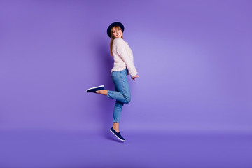 Wall Mural - Full length body size view photo cute pretty funny youth people person have holidays  candid glad amazed isolated dressed sweater modern jeans fashionable blue sneakers purple vivid background