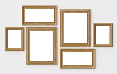 Wooden picture or photo frames on white wall with shadows with c
