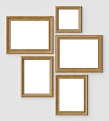 Wood picture or photo frames on white wall with shadows with copy-space