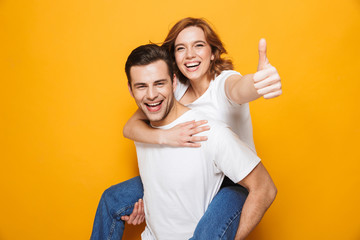 Portrait of a cheerful young couple standing Wall mural