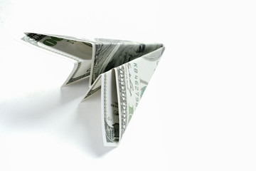 Paper plane made from dollar on white background