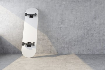 white skateboard on concrete wall background