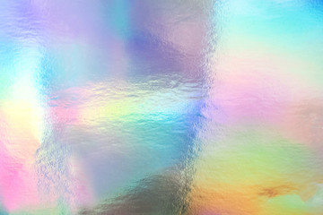 Holographic foil paper close-up. Modern trendy background